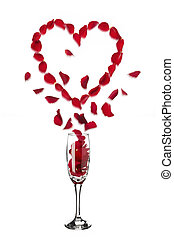 Heart shaped red rose petals popping out of champagne glass