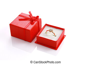 Heart shaped ring in red gift box isolated on white with copyspace