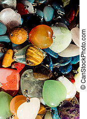 Heart shaped semi precious stones in view as a background