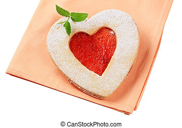 Heart shaped shortbread cookie with jam filling