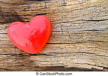 Heart shaped soap on wooden background - Heart shaped soap...