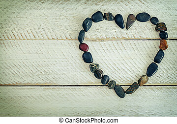 Heart shaped stone, small pebbles arranged as a heart on ...