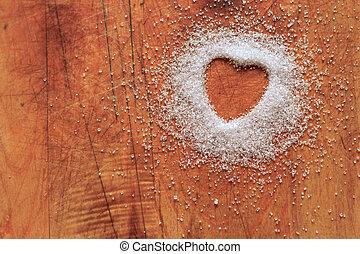 Heart-shaped sugar on cutting board
