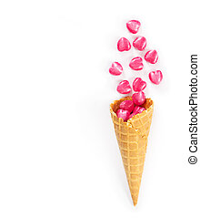 Heart shaped sweets in a waffle cone isolated on white