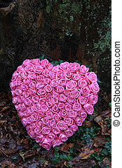 Heart shaped sympathy flower arrangement with pink roses