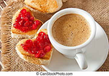 cup of coffee - heart-shaped toast with jam and a cup of...