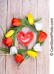 Heart shaped valentine gift with bunch of tulips