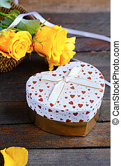 Heart shaped Valentines Day gift box and roses