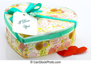 Heart-shaped Valentines Day gift box over a white