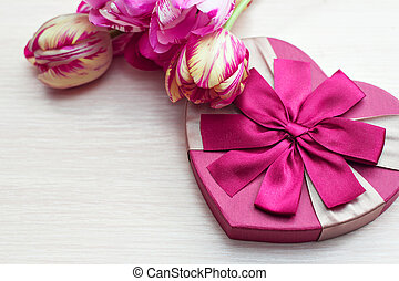 Heart shaped Valentines Day gift box with tulips and place for text