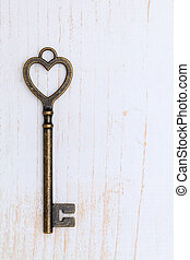 heart shaped vintage key - Antique key on white wood...