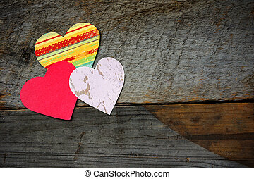 Heart shapes on barn wood background