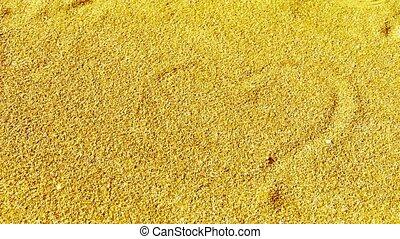 heart sign on golden sand.