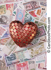 heart - A red heart with 1 Euro cent coins on bills