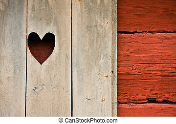 Heart symbol in a cottage\\\'s shutter