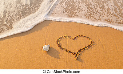 Heart symbol on sea shore beach