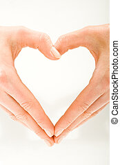 Heart - The form of heart shaped by female hands on a white...