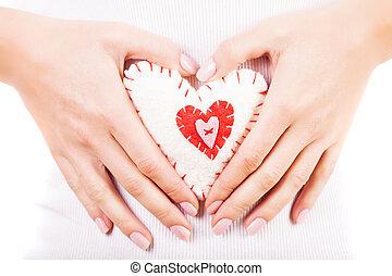 Heart toy in hands