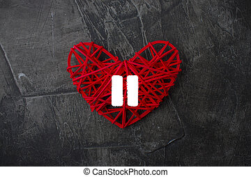 Heart with a sign of Pause on a dark background. Theme for Valentine's Day. Wedding