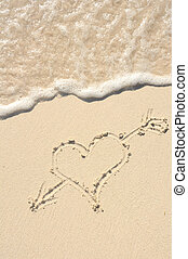 Heart with Arrow Drawn in Sand on Beach