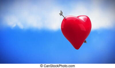 Digital animation of a rotating heart with cupid arrow on a sky background