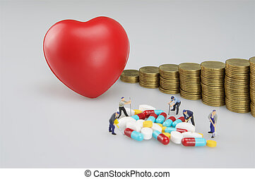Heart with gold coins step up and miniature people