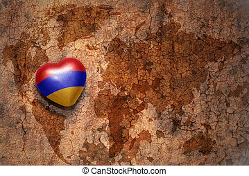 heart with national flag of armenia on a vintage world map crack paper background. concept