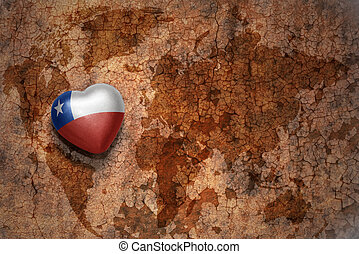 heart with national flag of chile on a vintage world map crack paper background. concept