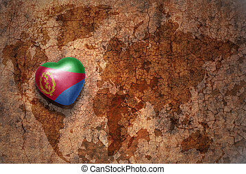 heart with national flag of eritrea on a vintage world map crack paper background.