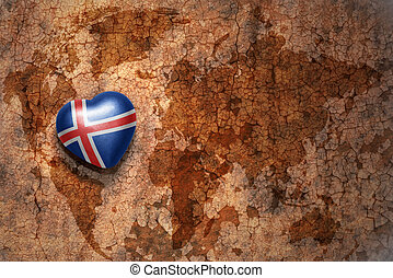 heart with national flag of iceland on a vintage world map crack paper background