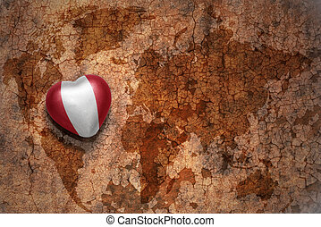 heart with national flag of peru on a vintage world map crack paper background. concept