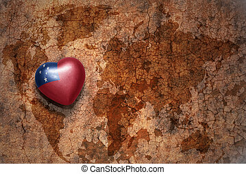 heart with national flag of Samoa on a vintage world map crack paper background. concept