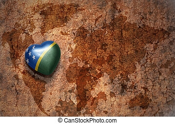 heart with national flag of Solomon Islands on a vintage world map crack paper background. concept