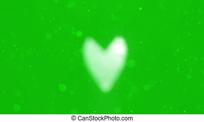 Heart with particles blur on Isolated green