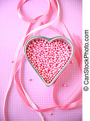 Heart with pink beads and ribbons