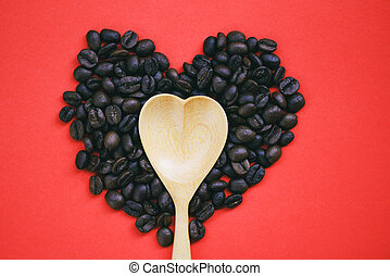 Heart wooden spoon on heart coffee beans romantic love valentines day on red background / love coffee concept