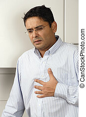 Heartburn pain Heartburn pain Heartburn pain - Man in his...