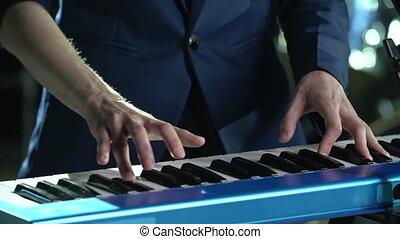 Heartfelt Song - Tilt from keyboard up to face of musician...