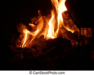 fire in a fireplace with a pan