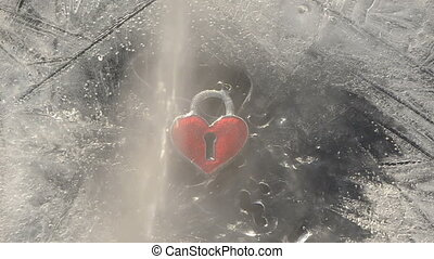 hearth in the winter ice and water - love symbol hearth in...