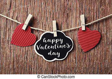 hearts and text happy valentines day - some red hearts hung...