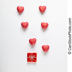 Hearts and toy present on white background.