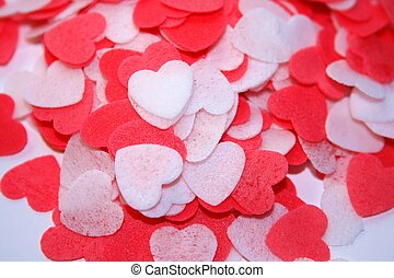 closeup of miniature red and white hearts