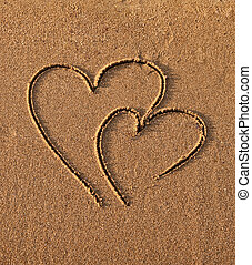 Hearts drawn on sand