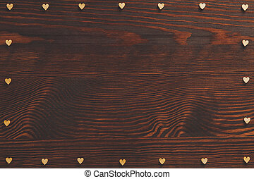 Hearts frame on wood table
