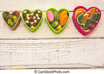 hearts frame, sweets on the background