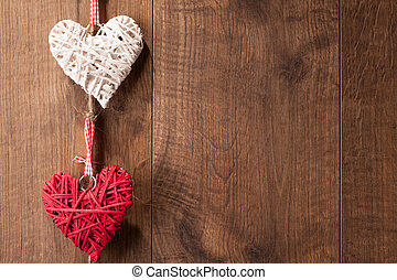 Hearts hanging on wooden wall
