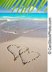 hearts in love written in Caribbean beach sand tropical aqua...