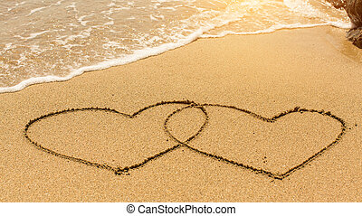 Hearts in the sand drawn