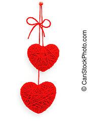 Hearts of yarn - Two woollen hearts made on yarn isolated on...